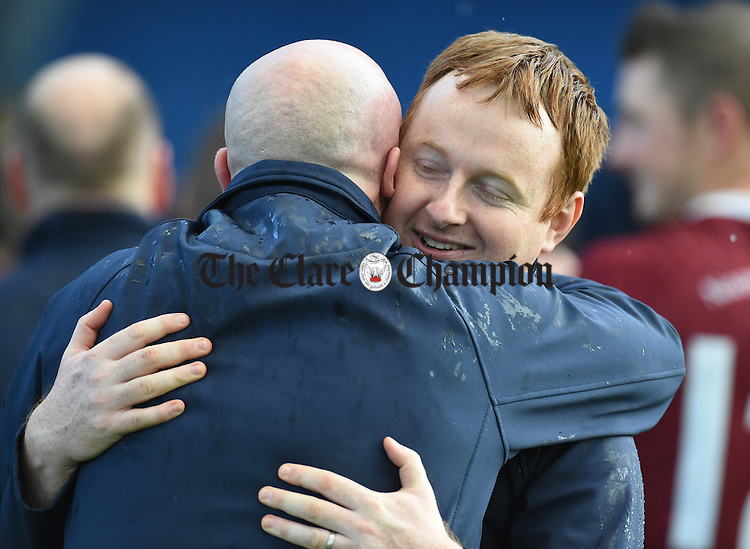 St Joseph's Doora Barefield manager Eamonn Corry is congratulated following their Intermediate county final win over Broadford  in Cusack Park. Photograph by John Kelly.