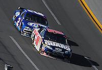 Apr 26, 2009; Talladega, AL, USA; NASCAR Sprint Cup Series driver Dale Earnhardt Jr (88) leads Kurt Busch (2) during the Aarons 499 at Talladega Superspeedway. Mandatory Credit: Mark J. Rebilas-