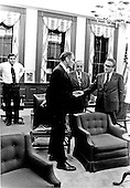 Washington, D.C. - August 8, 1974 -- White House Chief of Staff General Alexander M. Haig, Jr., left, White House Counsel James St. Clair, center, and United States Secretary of State Henry Kissinger, right, who is also the National Security Advisor,  share some conversation as United States President Richard M. Nixon prepares his resignation in Washington, D.C. on August 8, 1974.   Nixon made a nationally televised address at 9:00 PM that evening announcing his resignation..Credit: White House via CNP