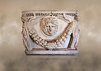 End panel of a Roman relief garland  sculpted sarcophagus, style typical of Pamphylia, 3rd Century AD, Konya Archaeological Museum, Turkey. Against a warm art background.