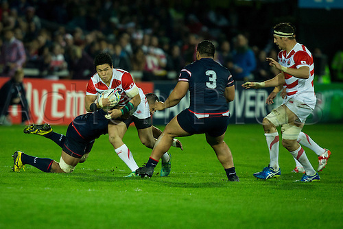 11.10.2015. Kingsholm Stadium, Gloucester, England. Rugby World Cup. USA versus Japan. Samu Manoa of USA stops Harumichi Tatekawa of Japan.