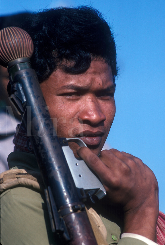 Cambodian Hun Sen soldier on patrol with weapon.