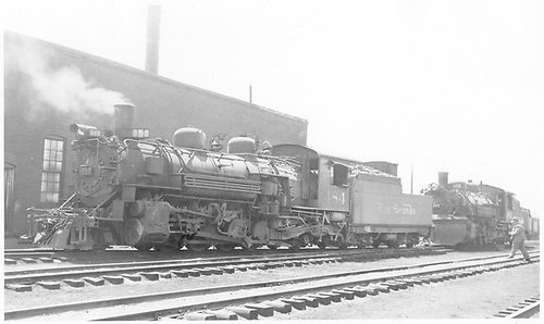 3/4 fireman side view of K-36 #484 next to Chama roundhouse.  K-36 #483 is behind #484.<br /> D&amp;RGW  Chama, NM  5/1946