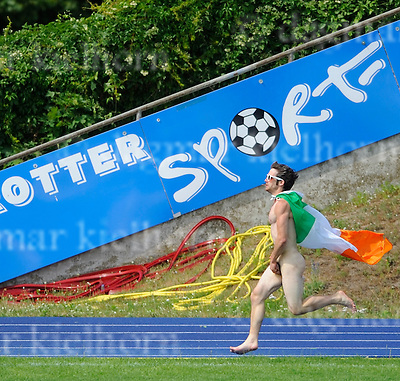 June 18-11,Stadium Lichterfelde,Berlin,Germany.A streaker from Ireland runs along the field  during the  Final match..Jizni Mesto wins 14 : 11  vs Global Starz .Berlin Open, one of the biggest and most traditional adult Lacrosse tournaments in Europe