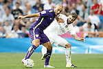 Real Madrid's Nacho Fernandez (r) and Malaga's Nordim Amrabat during La Liga match. September 26,2015. (ALTERPHOTOS/Acero)