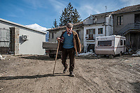 Santa Giusta, Italy, February 13, 2017. An elderly man walks in the village of Santa Giusta, hamlet of Amatrice, central Italy. Six months after the earthquake, nothing has changed. The rubble is still there; nothing has been moved, recorded or stored. People are still living in provisional accommodation but the greatest loss, to many residents, is the loss of their former peaceful lives.