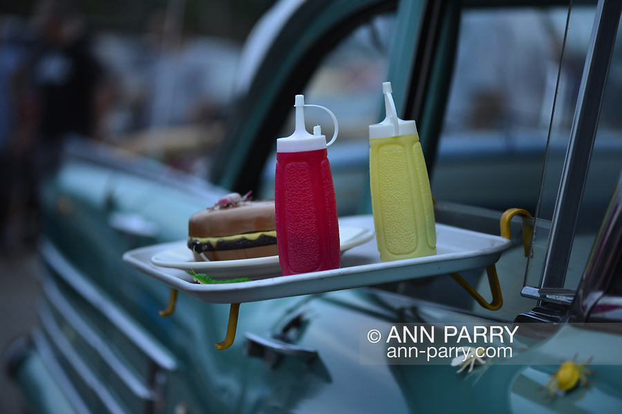 Bellmore, New York, USA. 11th August 2017. Hundreds of classic and custom cars are on display at Bellmore Friday Night Car Show, in the parking lot of the LIRR Bellmore station. This traditional Long Island event is hosted by the Chamber of Commerce of the Bellmores. MIKE RADOMSKI, of Valley Stream, owner of Wunderbug Woody Volkswagon, he made angel hood ornament from 3 silver forks, 10 penny nail, and a washer. ---- FRANK MARTOCCI, of Bellmore, BUGSBY cap, Bugmobile, owner of green Oldsmobile, 1958, Super 88 4-door sedan, his first and only car and he took his drivers test with it, owned for 40 years by next month --- JERRY YOREK, 1966 blue Buick Skylark, 2-door sedan, retired