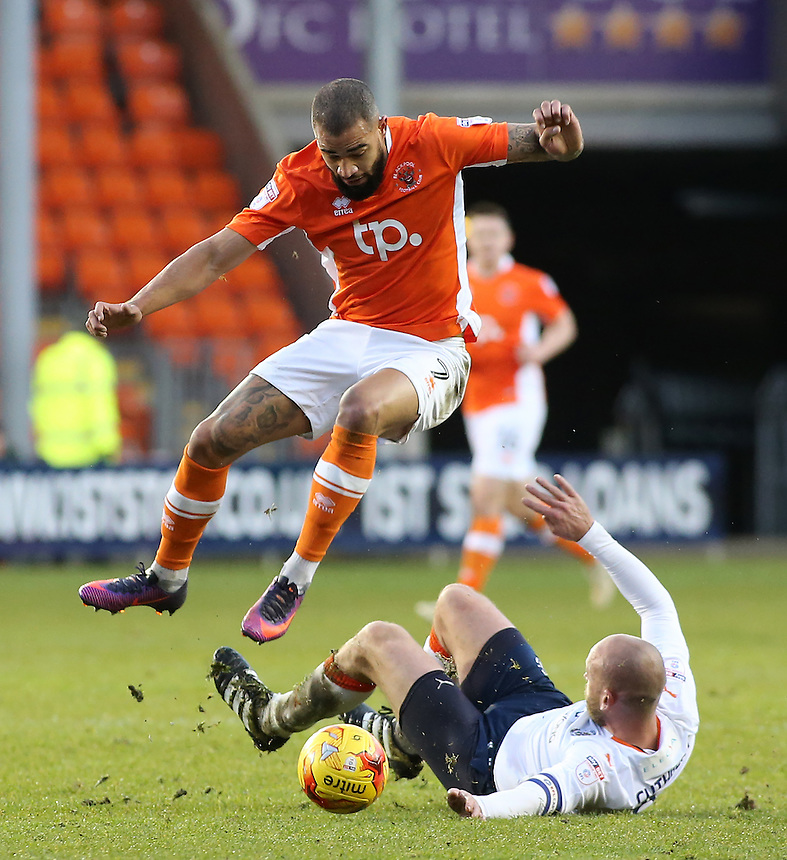 Blackpool's Kyle Vassell is tackled by Luton Town's Scott Cuthbert<br /> <br /> Photographer David Shipman/CameraSport<br /> <br /> The EFL Sky Bet League Two - Blackpool v Luton Town - Saturday 17th December 2016 - Bloomfield Road - Blackpool<br /> <br /> World Copyright &copy; 2016 CameraSport. All rights reserved. 43 Linden Ave. Countesthorpe. Leicester. England. LE8 5PG - Tel: +44 (0) 116 277 4147 - admin@camerasport.com - www.camerasport.com