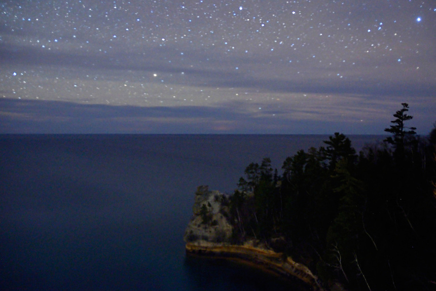 A moonless night at Miners Castle with faint Northern Lights in the distance. Munising, MI - Pictured Rocks National Lakeshore