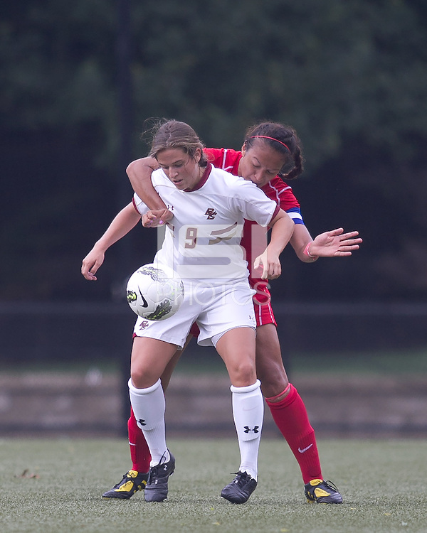 Boston College forward Stephanie McCaffrey (9) controls the ball as Boston University defender Lina Cords (23) defends. After 2 complete overtime periods, Boston College tied Boston University, 1-1, after 2 overtime periods at Newton Soccer Field, August 19, 2011.