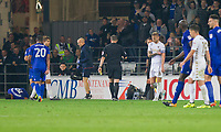 Liam Cooper of Leeds United takes off his captain's armband after being shown a red card during the Sky Bet Championship match between Cardiff City and Leeds United at the Cardiff City Stadium, Cardiff, Wales on 26 September 2017. Photo by Mark  Hawkins / PRiME Media Images.