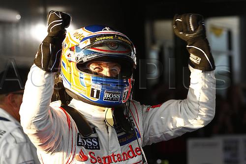 18.03.2012. Melbourne, Australia.   FIA Formula One World Championship 2012 Grand Prix of Australia 3 Jenson Button GBR Vodafone McLaren Mercedes shows his delight at winning the grand prix.   Jenson Button won the race with Sebbastian Vettel in second and Lewis Hamilton in third place.