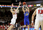 VERMILLION, SD - JANUARY 24: Reed Tellinghuisen #23 from South Dakota State University spots up for a jumper over Nick Fuller #34 from the University of South Dakota during their game Wednesday night at the Sanford Coyote Sports Center in Vermillion, SD. (Photo by Dave Eggen/Inertia)