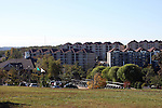 A golf course headquarters and greens surrounded by multi floored condos and timeshares in Branson Missouri