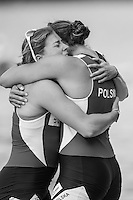 Lucerne, SWITZERLAND<br /> <br /> &quot;Qualification&quot; The Polish women&rsquo;s pair hug on the dock after winning a place in Rio. [POL W2-] 2016 European Olympic Qualifying Regatta, Lake Rotsee.<br /> <br /> Tuesday  24/05/2016<br /> <br /> [Mandatory Credit; Peter SPURRIER/Intersport-images]