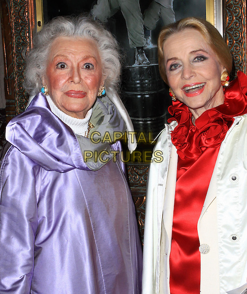 """ANNE RUTHERFORD & ANNE JEFFREYS .Opening Night Of """"STOMP"""" held At The Pantages Theatre, Hollywood, California , USA, 26th January 2010..arrivals portrait headshot  purple silk satin coat white red ruffle neck blouse  top  .CAP/ADM/KB.©Kevan Brooks/AdMedia/Capital Pictures."""