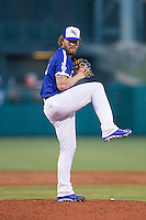Oklahoma City Dodgers pitcher Rudy Owens (19) winds up on the mound in a Pacific Coast League game against the Nashville Sounds at Chickasaw Bricktown Ballpark on April 15, 2015 in Oklahoma City, Oklahoma. Oklahoma City won 6-5. (William Purnell/Four Seam Images)