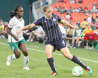 Cat Whitehill #4 of the Washington Freedom sends over a cross in front of India Trotter #11 during a WPS match against St. Louis Athletica on May 1 2010, at RFK Stadium, in Washington D.C.Freedom won 3-1.