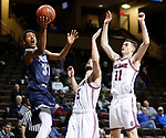 SIOUX FALLS, SD: MARCH 22: Gokul Natesan #31 of Colorado Mines shoots past Bellarmine defenders Rusty Troutman #5 and Alex Cook #11 during the Men's Division II Basketball Championship Tournament on March 22, 2017 at the Sanford Pentagon in Sioux Falls, SD. (Photo by Dick Carlson/Inertia)