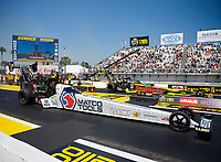Mar 19, 2017; Gainesville , FL, USA; NHRA top fuel driver Antron Brown (near) races alongside Troy Coughlin Jr during the Gatornationals at Gainesville Raceway. Mandatory Credit: Mark J. Rebilas-USA TODAY Sports