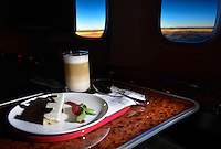 """""""Morning Coffee"""" by Art Harman. A flight to Asia as dawn breaks, and a respite from jet lag on the tray."""