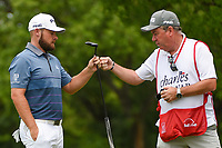 Tyrrell Hatton (ENG) fist bumps his caddie after sinking his birdie putt on 2 during round 4 of the 2019 Charles Schwab Challenge, Colonial Country Club, Ft. Worth, Texas,  USA. 5/26/2019.<br /> Picture: Golffile | Ken Murray<br /> <br /> All photo usage must carry mandatory copyright credit (© Golffile | Ken Murray)