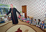 Cardinal Timothy Dolan, the archbishop of New York, visits children displaced by war in a preschool run by the Dominican Sisters of St. Catherine of Siena in Ankawa, near Erbil, Iraq, on April 9, 2016. <br /> <br /> Dolan, chair of the Catholic Near East Welfare Association, is in Iraqi Kurdistan with other church leaders to visit with Christians and others displaced by ISIS. The Dominican Sisters were themselves displaced by ISIS, and have established schools and other ministries among the displaced.