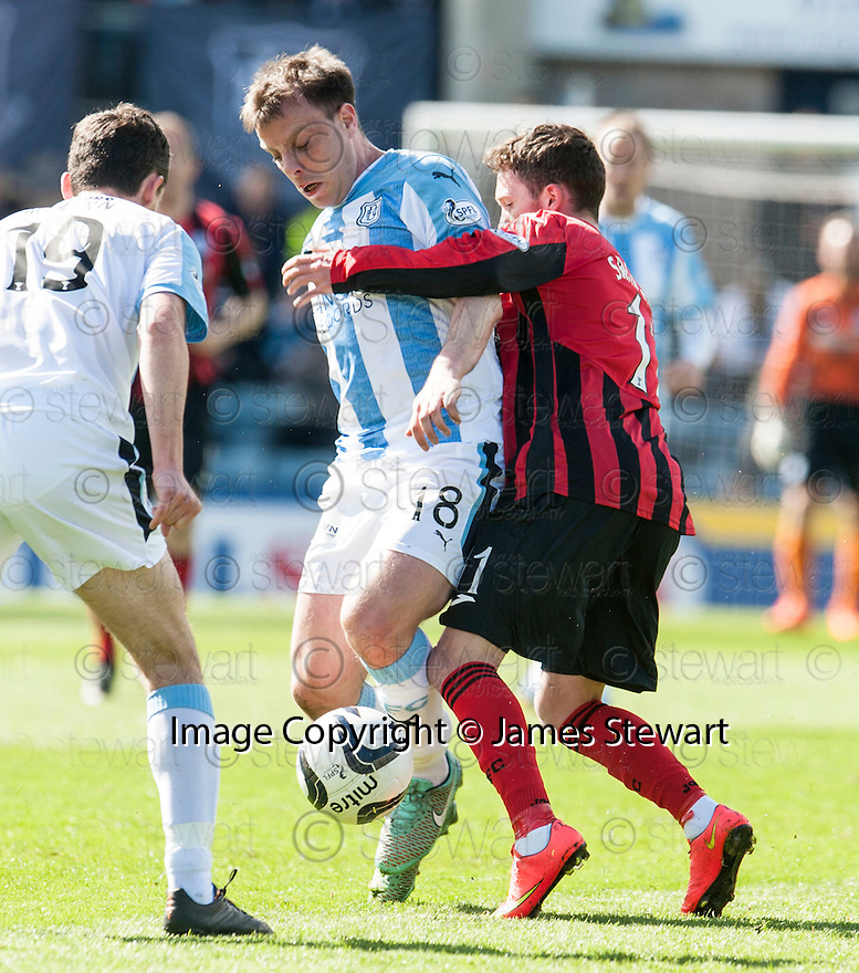 Dundee's Paul McGowan holds off St Johnstone's Danny Swanson.