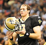 New Orleans Saints QB Drew Brees looks dejected as he stands on the sidelines after being pulled from the game in the 3rd quarter against the Tampa Bay Buccaneers Sunday Jan. 2,2011. The Bucs went on to win 23-13. The New Orleans Saints play the Tampa Bay Buccaneers in the last Sunday game of the regular  season before the playoffs in New Orleans at the Super Dome in Louisiana Sunday Jan 2, 2011.Photo©SuziAltman