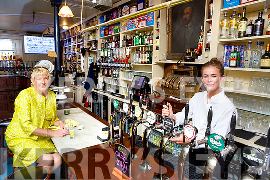 Patsy Foley enjoys a G+T and a good chat with Maeve McGill in the refurbished and reopened Reidy's bar in Killarney on Monday