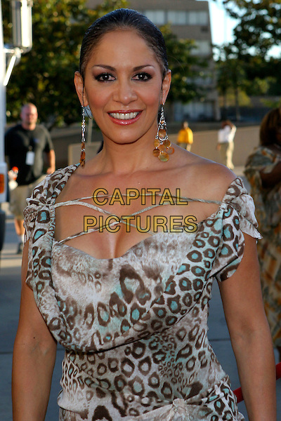 SHEILA E..2005 Soul Train Lady of Soul Awards - Arrivals held at the Pasadena Civic Center, Pasadena,  CA..September 7th, 2005.Photo credit: JW.half length animal pattern print off the shoulder dress dangling earrings cleavage.www.capitalpictures.com.sales@capitalpictures.com.© Capital Pictures.