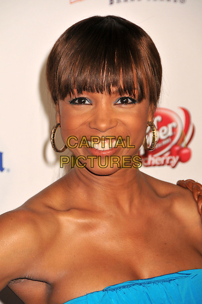 ELISE NEAL.Maxim Magazine's 10th Annual Hot 100 Celebration held at Barker Hangar, Santa Monica, CA, USA..May 13th, 2009.headshot portrait gold hoop earrings blue strapless .CAP/ADM/BP.©Byron Purvis/AdMedia/Capital Pictures.
