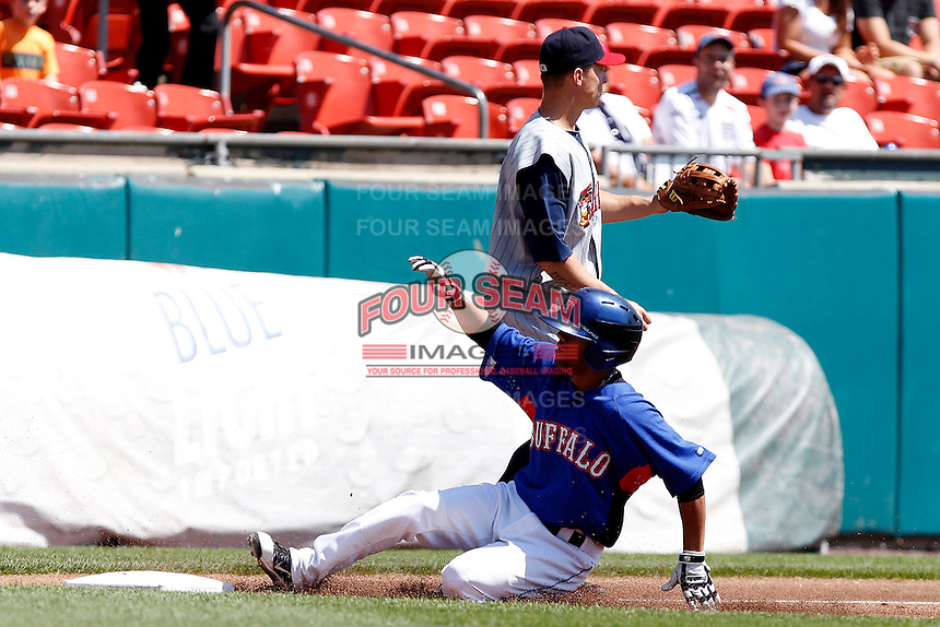 Buffalo Bisons outfielder Luis Figueroa #9 slides into third on a triple as Brandon Inge gets the throw during a game against the Toledo Mudhens at Coca-Cola Field on August 17, 2011 in Buffalo, New York.  Buffalo defeated Toledo 4-2.  (Mike Janes/Four Seam Images)