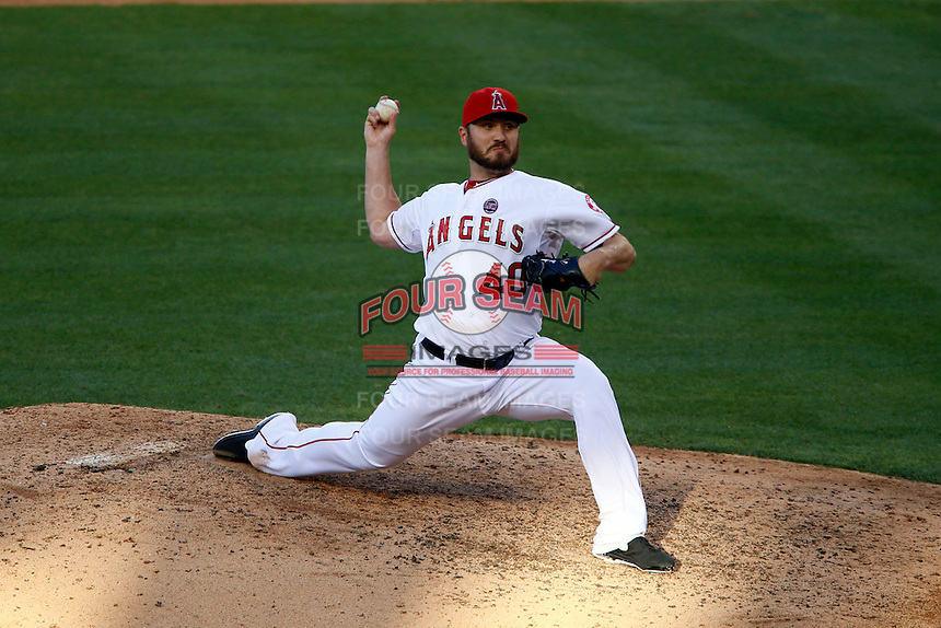 Kevin Jepsen #40 of the Los Angeles Angels pitches against the New York Yankees at Angel Stadium on June 15, 2013 in Anaheim, California. (Larry Goren/Four Seam Images)