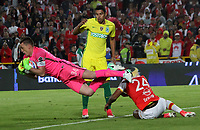 BOGOTA -COLOMBIA, 9-07-2017 Damir Ceter  (R)player of Independiente Santa Fe fights the ball agaisnt of Franco Armani and Daniel Bocanegra  (L)  players of Atletico Nacional during match for the date 1 of the Aguila League II 2017 played at Nemesio Camacho El Campin stadium . Photo:VizzorImage / Felipe Caicedo  / Staff