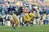 University of Michigan quarterback Denard Robinson (16) strikes a pose reminiscent of the Heisman trophy during the Wolverines' 28-24 victory over Notre Dame in South Bend, IN, on September 11th 2010. (Sam Wolson/The Michigan Daily)