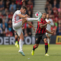 Sheffield United's John Egan (left) battles with Bournemouth's Callum Wilson (right) <br /> <br /> Photographer David Horton/CameraSport<br /> <br /> The Premier League - Bournemouth v Sheffield United - Saturday 10th August 2019 - Vitality Stadium - Bournemouth<br /> <br /> World Copyright © 2019 CameraSport. All rights reserved. 43 Linden Ave. Countesthorpe. Leicester. England. LE8 5PG - Tel: +44 (0) 116 277 4147 - admin@camerasport.com - www.camerasport.com