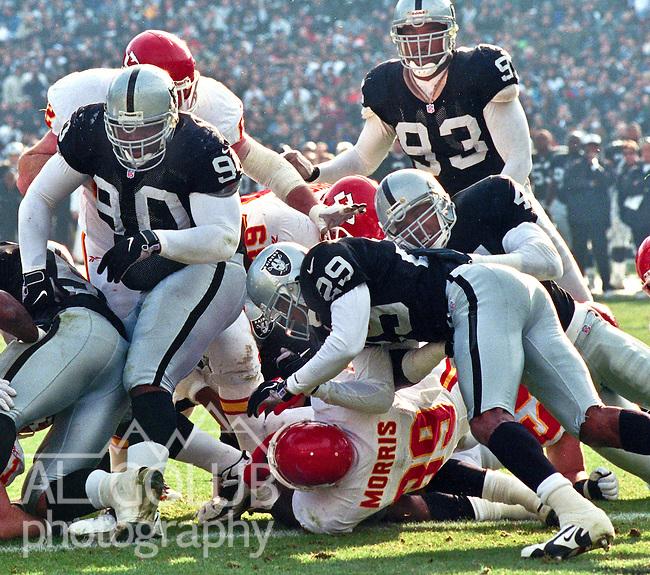 Oakland Raiders vs. Kansas City Chiefs at Oakland Alameda County Coliseum Saturday, December 26, 1998.  Chiefs beat Raiders  31-24.  Kansas City Chiefs running back Bam Morris (39) makes first down.