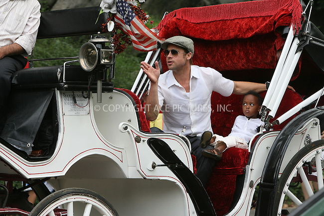 WWW.ACEPIXS.COM ** ** ** ....August 28 2007, New York City....Actor Brad Pitt took his adpoted daughter Zahara to Central Park in midtown Manhattan for a ride on a horse carriage, bought her an ice cream and then spent a period of quiet relaxation with her on Sheep Meadow.....Please byline: Philip Vaughan -- ACEPIXS.COM.. *** ***  ..Ace Pictures, Inc:  ..tel: (646) 769 0430..e-mail: info@acepixs.com..web: http://www.acepixs.com