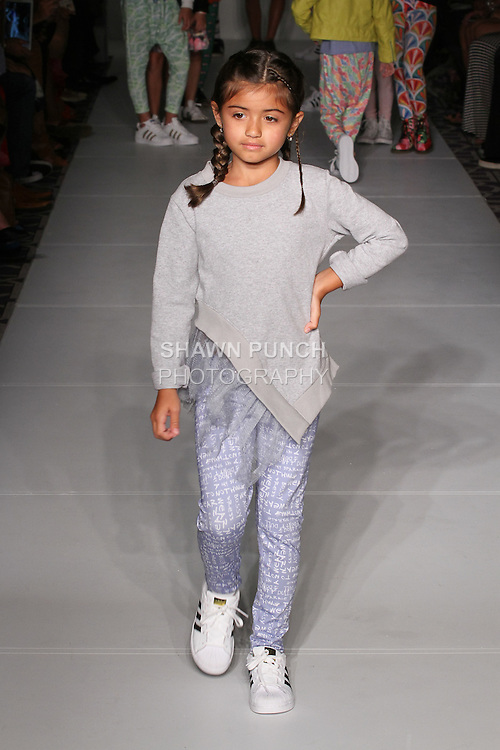Model walks runway in an outfit from the Chick by Glossy childrenswear Spring 2017 collection at the Emerging Designers Spring 2017 fashion show for FGNYFW on September 11, 2016; during New York Fashion Week Spring Summer 2017.