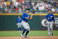 Durham Bulls third baseman Kean Wong (5) catches a pop fly during the game against the Charlotte Knights at BB&T BallPark on July 4, 2018 in Charlotte, North Carolina. The Knights defeated the Bulls 4-2.  (Brian Westerholt/Four Seam Images)