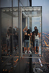 "Couples are seen on the newly opened glass balconies ""The Ledge"" at the Skydeck at the Sears Tower in Chicago, Illinois on July 6, 2009."