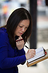 © Joel Goodman - 07973 332324 . 02/09/2013 . Bury , UK . A woman signs a book of condolence . The funeral of fireman Stephen Hunt at Bury Parish Church today (Tuesday 3rd September 2013) . Stephen Hunt died whilst tackling a blaze at Paul's Hair World in Manchester City Centre in July 2013 . Photo credit : Joel Goodman