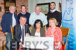 Marie Carroll presents a cheque of €44,000 the proceeds of  Nathan's Walk  to Pieta House n the Porter house on Monday evening front row l-r: Kieran Brady, Marie Carroll, Marie Peelo. Back row: Denis Carroll, Martin Driver, Kevin O'Donoghue and Kevin O'Callaghan