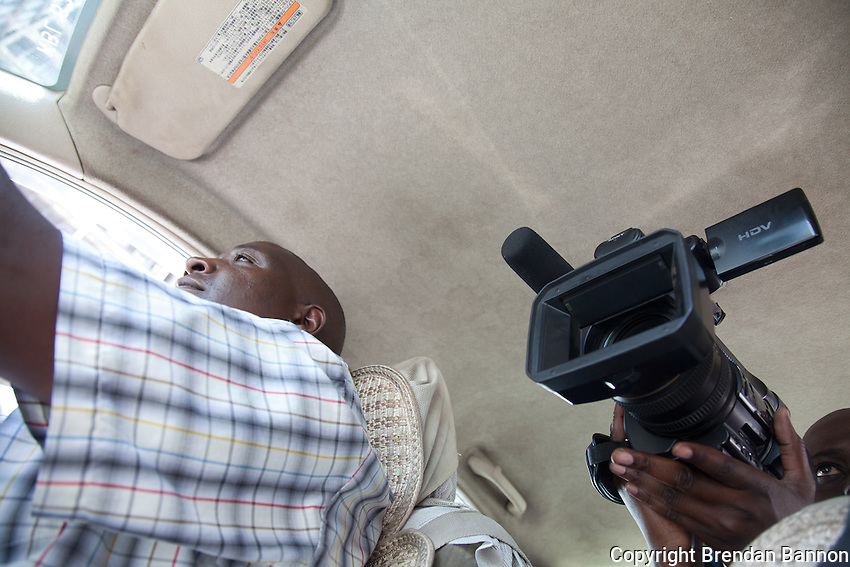 Robert Nagila, TV reporter for NTV, interviewing a Nairobi taxi driver for a vox pop segement gauging  reaction to Senior Kenyans' appearance at the International Criminal Court on criminal charges related to the 2007 post-election violence.