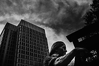 A statue of Benjamin Franklin as a craftsman stands outside the Municipal Services Building in Philadelphia, Pennsylvania, USA.