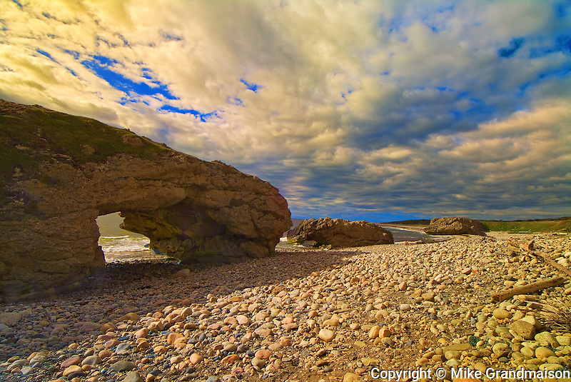 Limestone rock eroded by waves action forming an arch. Gulf of St. Lawrence<br /> Arches Provincial Park<br /> Newfoundland<br /> Canada