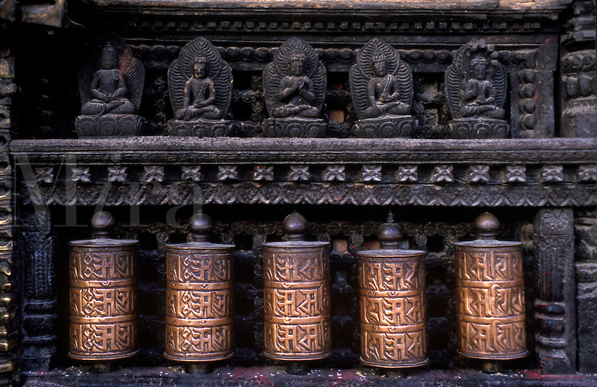 PRAYER WHEELS & CARVED BUDDHAS at the SWAYAMBUNATH temple complex - KATHAMANDU, NEPAL