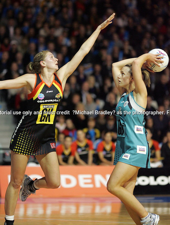 21.07.2008 Magic's Casey Williams and Thunderbirds Natalie Medhurst in action during the ANZ Champs netball Preliminary final match between the Magic and the Thunderbirds played at Mystery Creek in Hamilton. Mandatory Photo Credit ©Michael Bradley.