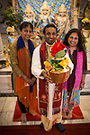 © Joel Goodman . 18 May 2013 . Gita Bhavan Hindu Temple , Withington Road , Whalley Range , Manchester . L-R Mrs Kusum Vyas PHD , Acharya (instructor) Shyam Sunder Sharma holding the pot and Dr Poonam Kakkar . Commemorative service to celebrate the handover of the Green Kumbh Yatra (green journey pot or environmental pilgrimage) at the Gita Bhavan Hindu Temple in Manchester . The pot has travelled to the Maha Kumbh Mela , Kenya , Nepal and the Western Wall in Jerusalem along the way . At every place of rest an environmental action must be taken to reflect the pot's environmental significance . It's due to travel to Leicester and feature in an outdoor procession in London on 24th May 2013 . Photo credit : Joel Goodman